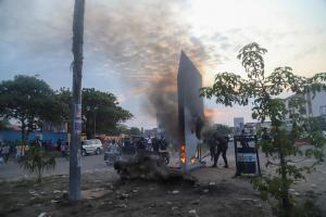 Residents set fire to the mysterious monolith that appeared in Kinshasa, Democratic Republic of Congo February 17, 2021. REUTERS/Kenni Katombe