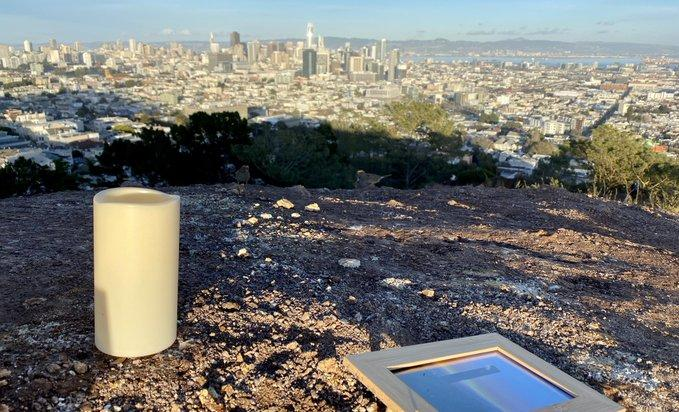 A solemn candle and a photograph where the monolith once stood.  Photo: Sergio Quintana / @svqjournalist, NBC News